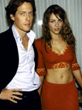 Actors Hugh Grant and Elizabeth Hurley at Party at Mondrian Preceding Golden Globe Awards Premium Photographic Print by Dave Allocca