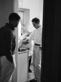 Actor Paul Newman Cooking Eggs for Guests Incl. Anthony Perkins During an Informal Party Premium Photographic Print