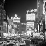 Brightly Lit Signs Shining over Traffic Going Down Broadway Towards Times Square Fotodruck von Andreas Feininger