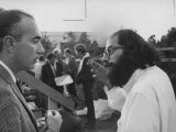 Hippie Poet Allen Ginsberg Speaking to Conservative-Looking Man During Vietnam War Protest Rally Premium Photographic Print