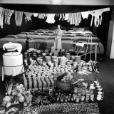Housewife Marjorie McWeeney with Broom Amidst Display of Her Week's Housework, Bloomingdale's Store Photographic Print by Nina Leen