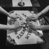 People Playing with a Ouija Board Photographic Print