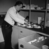 Servant Aboard the Atlantic Clipper Preparing Dessert Plates for the Passengers Aboard Photographic Print by Bernard Hoffman