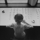 Newly Trained Girl Sorting Thousands of Dollars Worth of Diamonds Photographic Print by Bob Landry