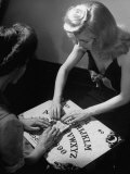 People Playing with a Ouija Board Premium Photographic Print