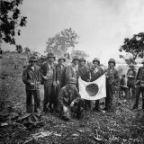 US Marines Holding Japanese Flag Captured During First Days of the Saipan Offensive Photographic Print by Peter Stackpole