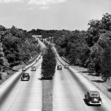 Cars Riding on Merritt Parkway with Bridge in Background Photographic Print by Bernard Hoffman