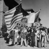 Mexican Farm Workers Waving American and Mexican Flags Lámina fotográfica por J. R. Eyerman