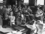 Fourth Graders Studying a Picture of a Tooth During and Intelligent Test in Class Premium Photographic Print by Nina Leen