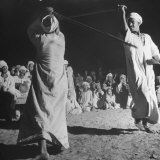 Men Performing the Stick Dance Photographic Print