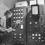 Engineer Grote Reber Is Studying the Gages of the Control Panel to the Radiometer Photographic Print