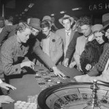Playing the Roulette Wheel in a Las Vegas Club Photographic Print by Peter Stackpole