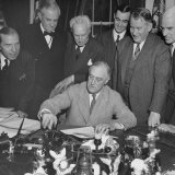 President Franklin D. Roosevelt Signing Lend-Lease Extension Photographic Print by Myron Davis