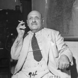 Bechara El-Khowry Sitting in Chair and Smoking Photographic Print
