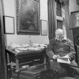 British Leader Winston Churchill Working in His Office, with Painting of Wife Hanging on the Wall Photographic Print