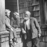 Old Man Talking to Two Young Boys Photographic Print by Peter Stackpole
