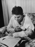 Father Feeding His Baby So That His Wife Can Go to the Movies Photographic Print by Alfred Eisenstaedt