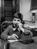 7 Year Old Boy Making a Telephone Call to Santa Claus Premium Photographic Print by Martha Holmes
