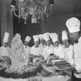 Chefs Lining Up Behind their Displays Reproduction photographique par Loomis Dean