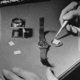 Agent at the Fbi Using Tweezers to Hide Microfilm in the Back of a Wristwatch Photographic Print