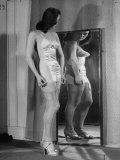 "Girl Looking at Herself Wearing the Board of Trade's ""Utility"" Underwear Premium Photographic Print by Bob Landry"
