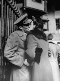 Soldier Giving a Farewell Kiss to His Lady Friend at Penn Station before Shipping Out Photographic Print by Alfred Eisenstaedt
