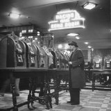 Man Playing the Slot Machines Photographic Print by Ralph Morse