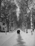 Couple Walking Through a Snow Covered Road Photographic Print by Carl Mydans