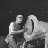 Man Working at One of the Sun Shipbuilding and Drydock Co. Shipyards Photographic Print