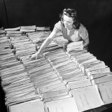 File Clerk at the Fbi Working with a Table Covered with Files Photographic Print