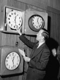 An Employee Checking the Time and Sees to it That the Clocks are Accurate Premium Photographic Print by Peter Stackpole
