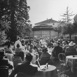 People Sitting at Tables on Terrace of Baur-Au-Lac Hotel Photographic Print