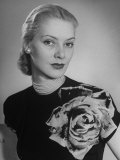 Woman Wearing Dress Made of Fabric Containing Photograph of a Rose Premium Photographic Print by Nina Leen