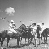 Polo Players Preparing for a Game at the Canlubang Country Club Photographic Print by Carl Mydans