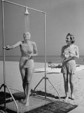 Shapely Sunbather Taking an Outdoor Shower as Woman Preparing for Her Turn, Looks On, at Beach Photographic Print by Alfred Eisenstaedt