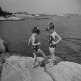 Two Little Girls Modelling Sun Dot Bathing Suits While Playing on the Rocks Photographic Print by Nina Leen