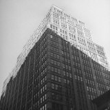 The Sun Shining on the Top Half Od the Building Photographic Print by Ralph Morse