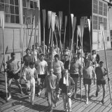 Washington Univ. Rowing Team Showing Up for Practice Photographic Print by J. R. Eyerman