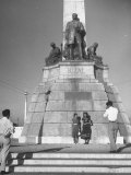 Two Women Posing in Front of the Statue of the Philippine Hero Jose Rizal Premium Photographic Print