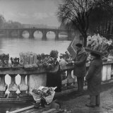 People Buying Flowers from the Flower Stall Near the Banks of Pont Neuf Photographic Print by Ed Clark