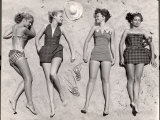 Models Sunbathing, Wearing Latest Beach Fashions Premium Photographic Print by Nina Leen