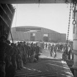 Amer. Army Troops Being Loaded into Lst Landing Craft Which Will Take Them to the Front in Italy Photographic Print by Margaret Bourke-White