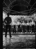 Doorman Facing Six Bellhops Who are Standing at Attention at the Entrance of the Surf Club Premium Photographic Print by Alfred Eisenstaedt