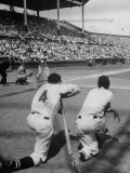 Batter Getting Ready for Pitch While Other Players are Waiting their Turn to Bat Photographic Print by Allan Grant