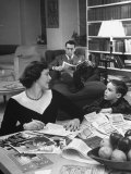 American Housewife Margaret Carson Sitting at Home with Her Husband and Son Premium Photographic Print by Nina Leen