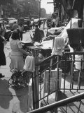 Street Vendors Selling on the Sidewalk Premium Photographic Print by Ed Clark