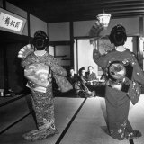 Two Geishas Dancing with Fans on Stage as Guests and Other Geshias Watch from Dinner Table Photographic Print by Alfred Eisenstaedt