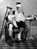 Heavily Bandaged English Man Sitting in Wheelchair with a Child, an Advertisment for a Health Plan Premium Photographic Print