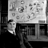 "Minister of Health Aneurin Bevan, Sitting Beneath ""National Health Service"" Poster Photographic Print"