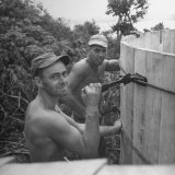 US Navy Seabees Building Wooden Water Tanks Photographic Print by J. R. Eyerman